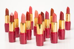 Lipsticks. Group of multi-coloured lipsticks on a white background Royalty Free Stock Image