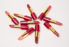 Lipsticks. Group of multi-coloured lipsticks on a white background Stock Photo