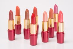 Lipsticks. Group of multi-coloured lipsticks on a white background Royalty Free Stock Images