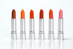 Lipsticks. Group of multi-coloured lipsticks on a white background Stock Image