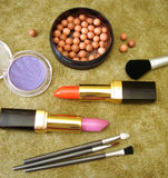 Lipsticks and brown rouge Stock Photos