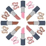 Lipsticks of different  colors and butterflies Stock Photography