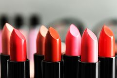 Lipsticks in different shades. Closeup Royalty Free Stock Photography