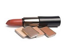 Lipsticks and eye-shadows. Isolated on white background Royalty Free Stock Photo