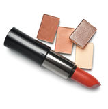 Lipsticks and eye-shadows Stock Images