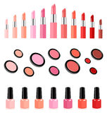Lipsticks, face powders and nail varnish in matching colors Royalty Free Stock Photos