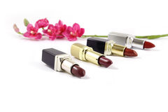 Lipsticks and flowers. Isolated Stock Photos