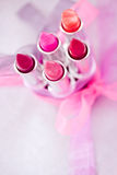 Lipsticks and lipglosses with bow. A set of lipsticks/lipglosses with decorative bows Stock Photography
