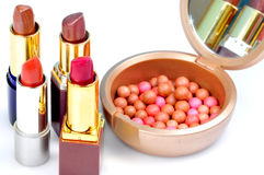 Lipsticks and makeup balls Royalty Free Stock Photo