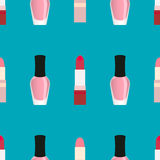 Lipsticks with nail polish seamless pattern. Red and light pink lipsticks and light pink nail polish at a blue background Royalty Free Stock Photos