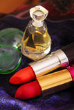 Lipsticks and perfume Royalty Free Stock Photo