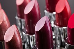 Lipsticks in a row Royalty Free Stock Photos