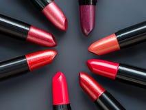 Lipsticks set on abstract gray background stock photos