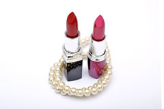 Lipsticks shades with pearl isolated on white Royalty Free Stock Photo