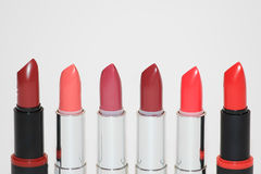 Lipsticks in various colors Stock Photography