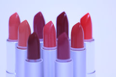 Lipsticks in various colors Stock Images