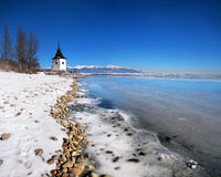 The Liptovska Mara lake frozen with ice Stock Photos