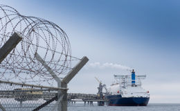 Liquefied natural gas tanker. At the port Stock Photos
