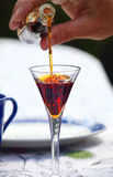 Liqueur being poured into glass. Photo of Liqueur being poured into glass Stock Images