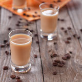 Liqueur with coffee. Coffee liqueur on the wooden table, selective focus Stock Photos