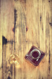 Liqueur in glass and bottle in brown background Royalty Free Stock Image