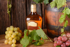 Liqueur in the glass bottle Royalty Free Stock Photos