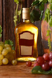 Liqueur in the glass bottle Royalty Free Stock Photography