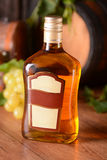 Liqueur in the glass bottle Stock Photography