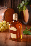 Liqueur in the glass bottle Stock Images