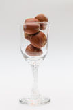 Liqueur glass with nuts Royalty Free Stock Photography