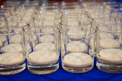Liqueur glasses in a row Royalty Free Stock Photography