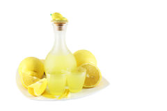 Liqueur Limoncello. Italian liqueur Limoncello with lemon royalty free stock photo