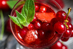 Liqueur made of wild berries and mint Stock Photos