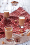 Liqueur with nut. Sweet Liqueur with nut, selective focus Royalty Free Stock Photo