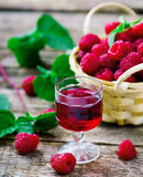 Liqueur from raspberry in a shot glass. Liqueur from raspberryberry in a shot glass. style rustic. selective focus stock photography