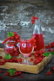 Liqueur of red currant in the glass royalty free stock photography