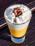 Liqueur with whipped cream and cocoa powder, eggnog Royalty Free Stock Photos