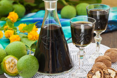 Liqueur from young green walnuts Stock Photography