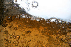 Liquid. Big and small bubbles in liquid Stock Photos
