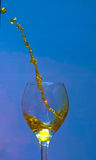 Liquid being poured into a glass Royalty Free Stock Images