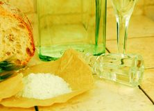 Liquid in a bottle, wineglasses, bread and salt Royalty Free Stock Photos