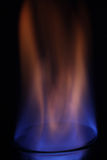 Liquid burning blue flame Stock Image