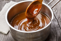 Liquid caramel is poured Royalty Free Stock Photography