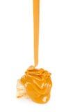 Liquid caramel runs down the candy nougat Stock Photo