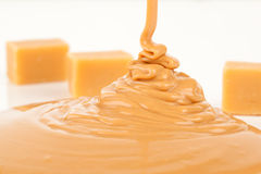 Liquid caramel. On white background Stock Photo