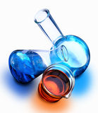 Liquid Chemicals. Beaker, erlenmeyer flask and boiling flask with chemicals Stock Photography