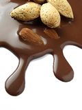 Liquid chocolate with almonds, Royalty Free Stock Photos