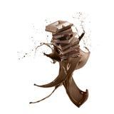 Liquid chocolate. Liquid splash chocolate around stack of chocolate blocks, isolated on white Royalty Free Stock Photo