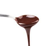 Liquid chocolate on a spoon. Royalty Free Stock Photos