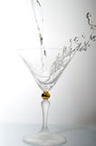 Liquid in cocktail glass. Pouring liquid into cocktail glass Stock Photos